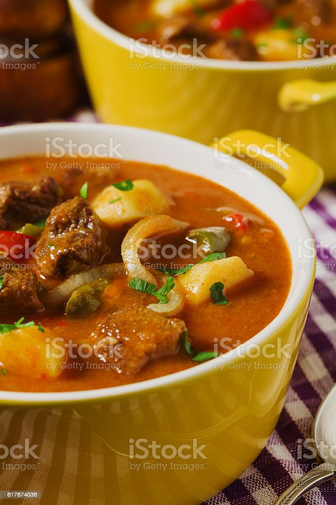 Beef stew served with cooked potatoes. stock photo