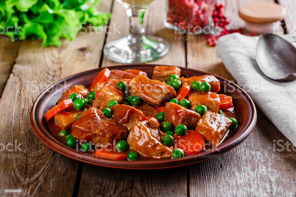 beef stew with peas and carrots stock photo