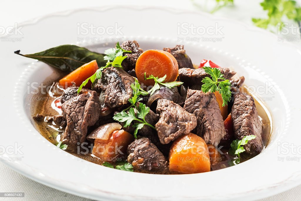 Beef stew  with vegetables in restaurant . Selective focus. stock photo