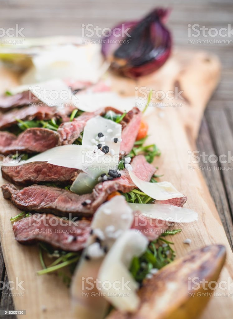Beef Tagliata With Vegetables and Covered in Parmesan stock photo