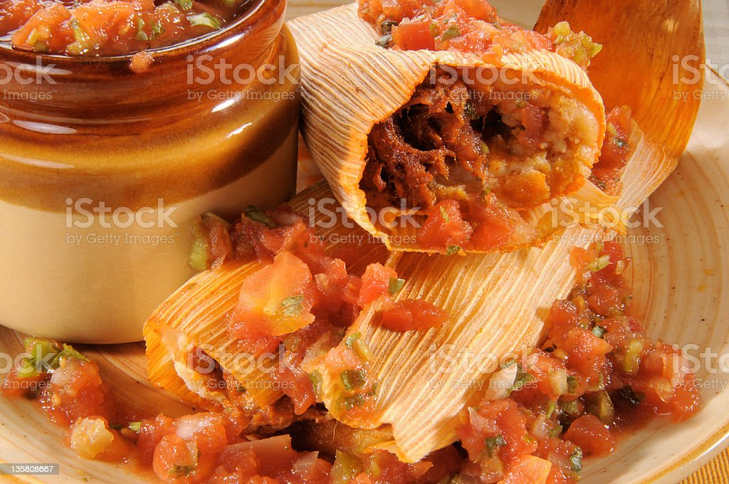 Beef tamales and salsa stock photo