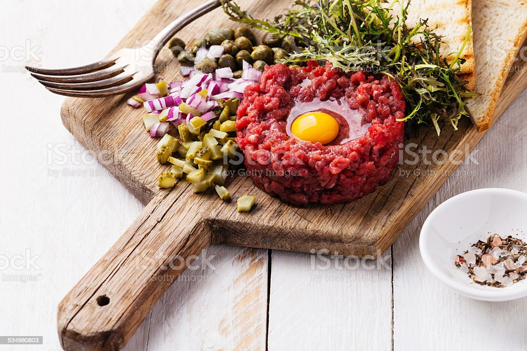Beef tartare with capers and onion stock photo