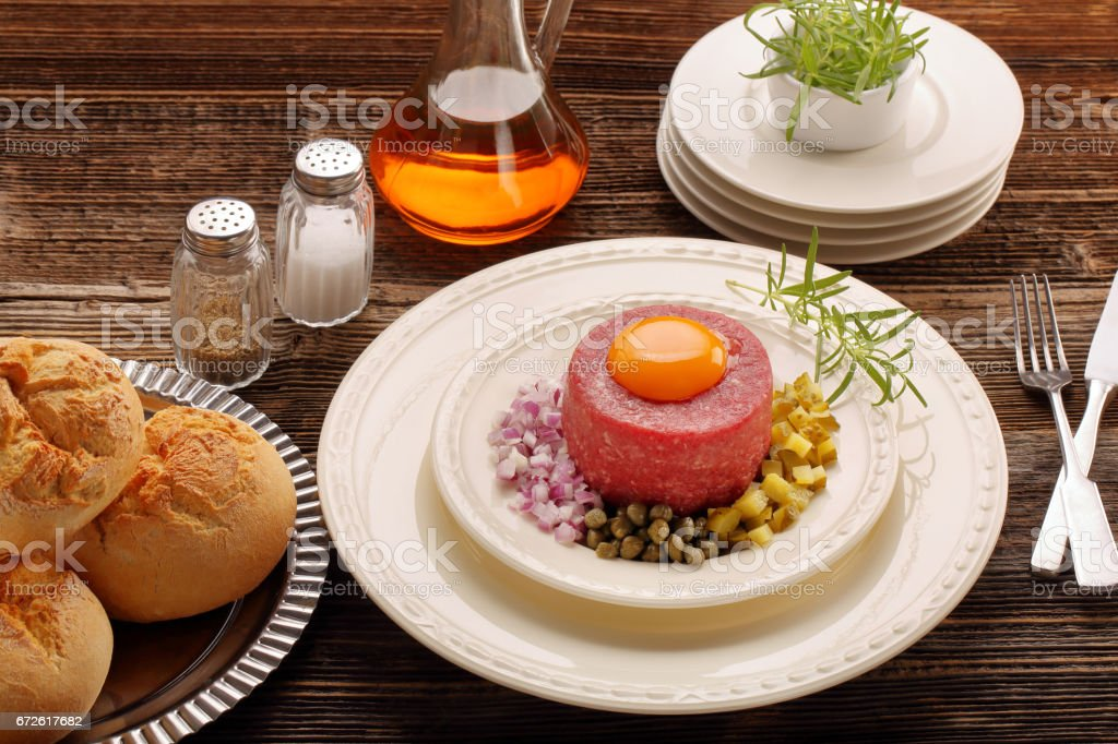 Beef tatare with egg stock photo