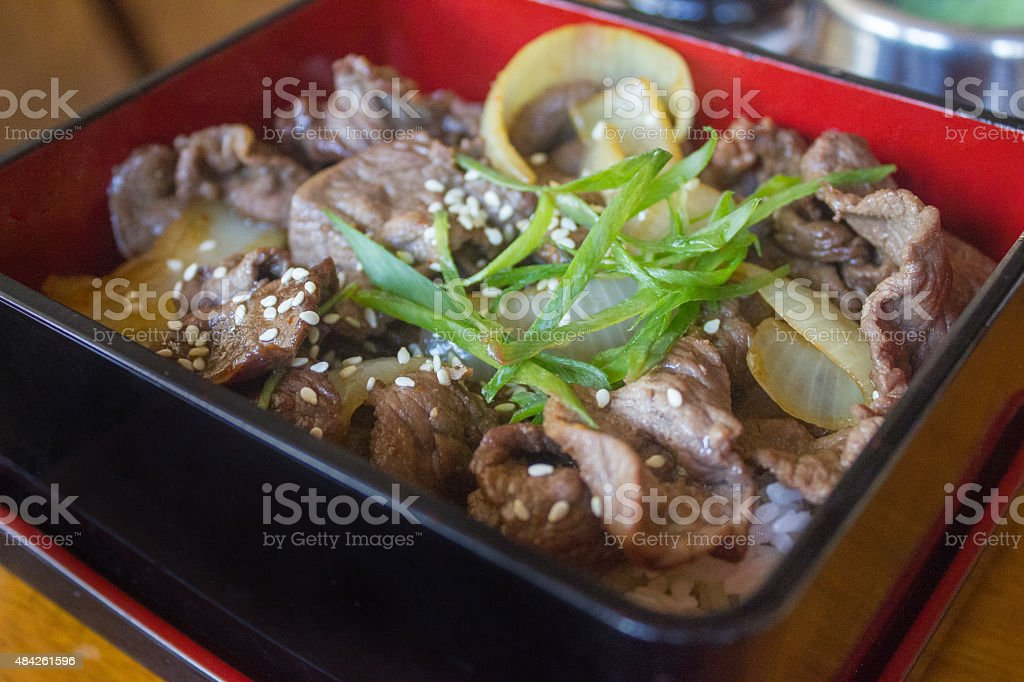 Beef teriyaki inside red bento stock photo