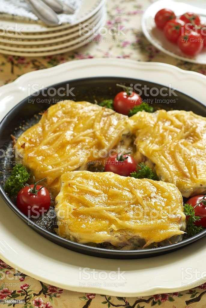 Beef tongue, baked with cheese and onions royalty-free stock photo