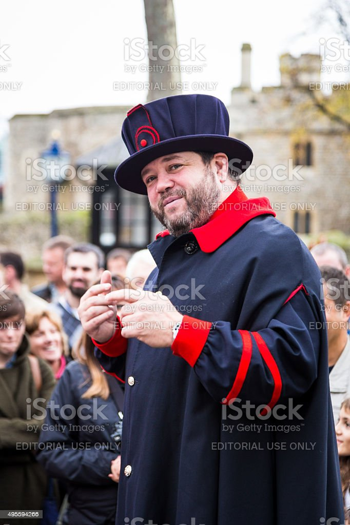 Beefeater conducting a tour at the Tower of London, London, UK stock photo