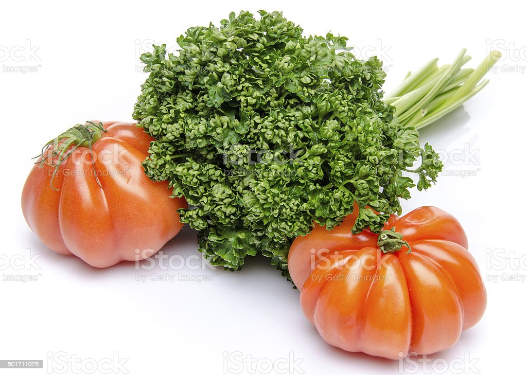 Beefsteak tomatoes with parsley stock photo