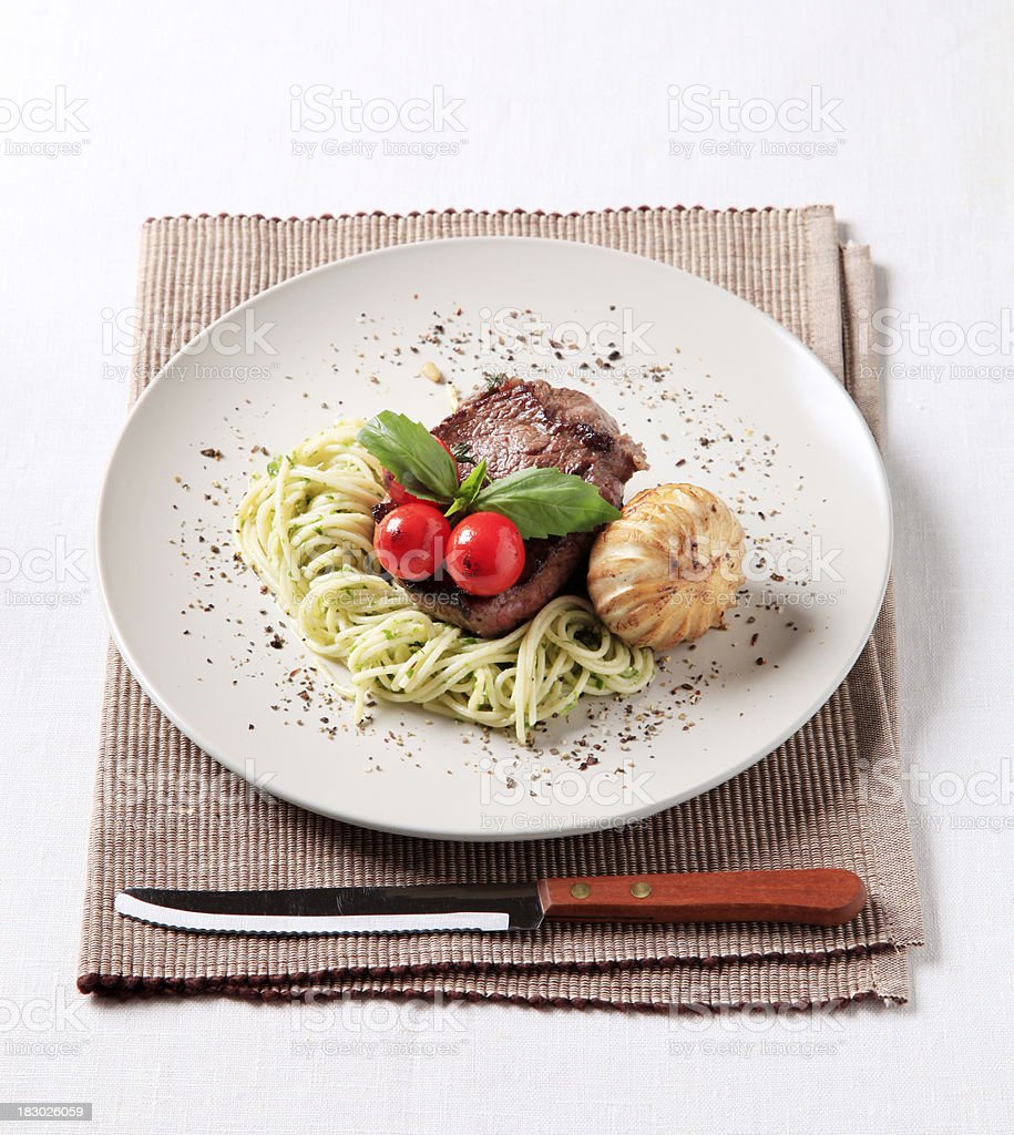 Beefsteak with spaghetti and grilled garlic royalty-free stock photo