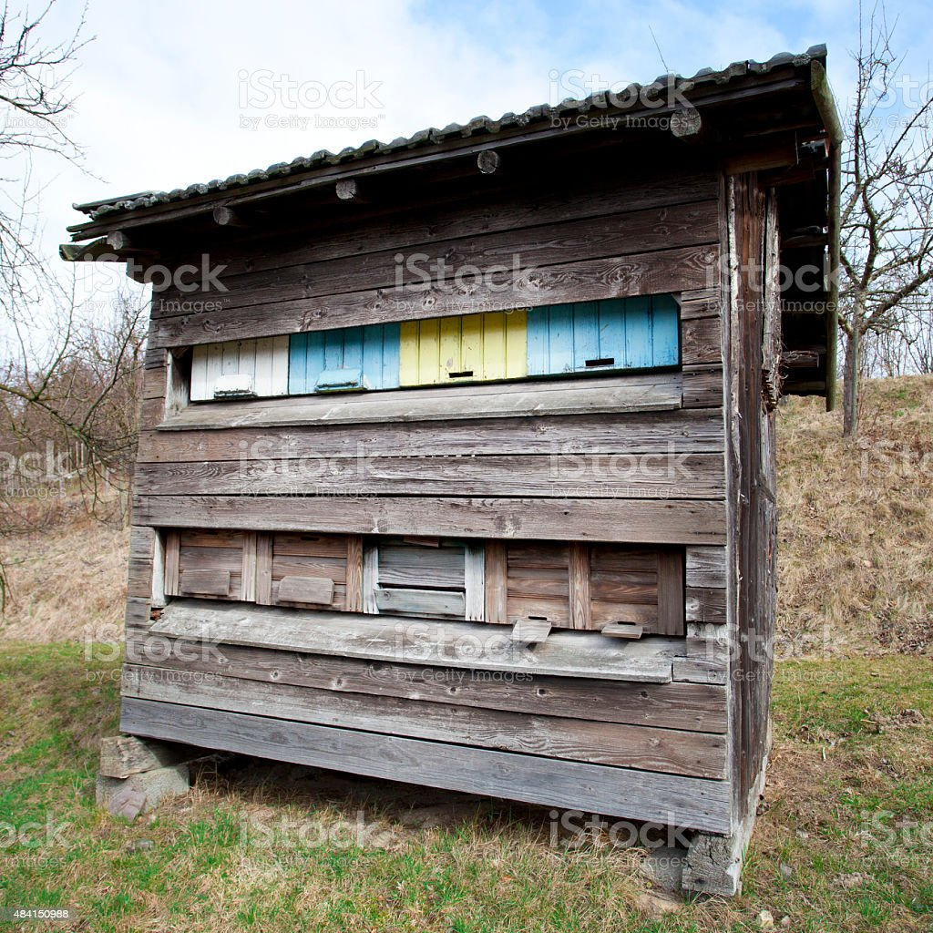 Beehives in an old weathered wooden hut stock photo