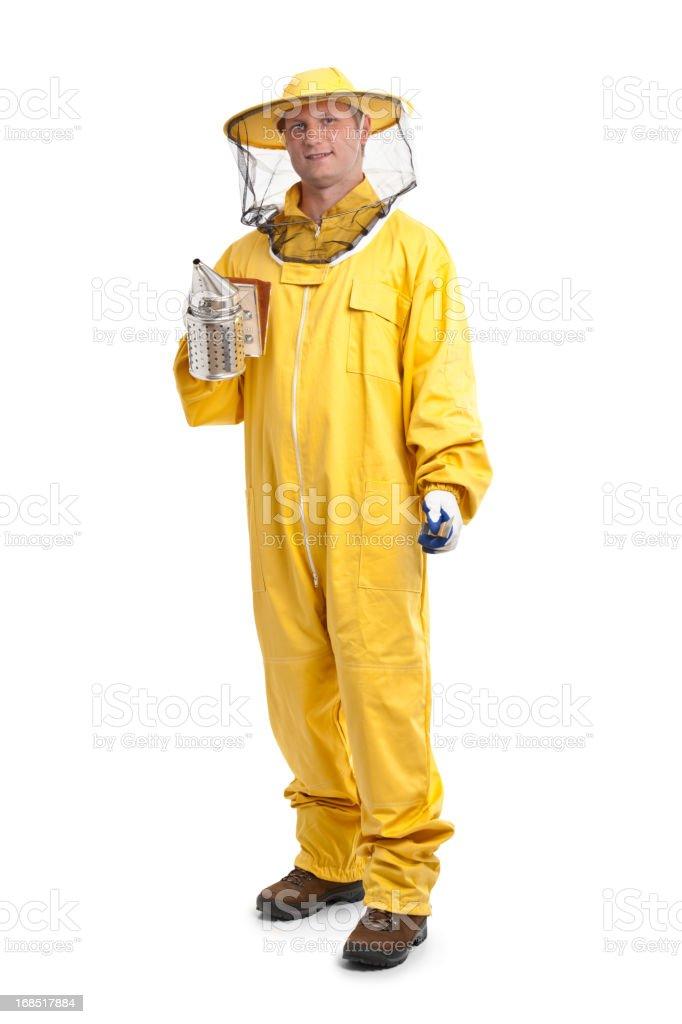 beekeeper in yellow uniform stock photo