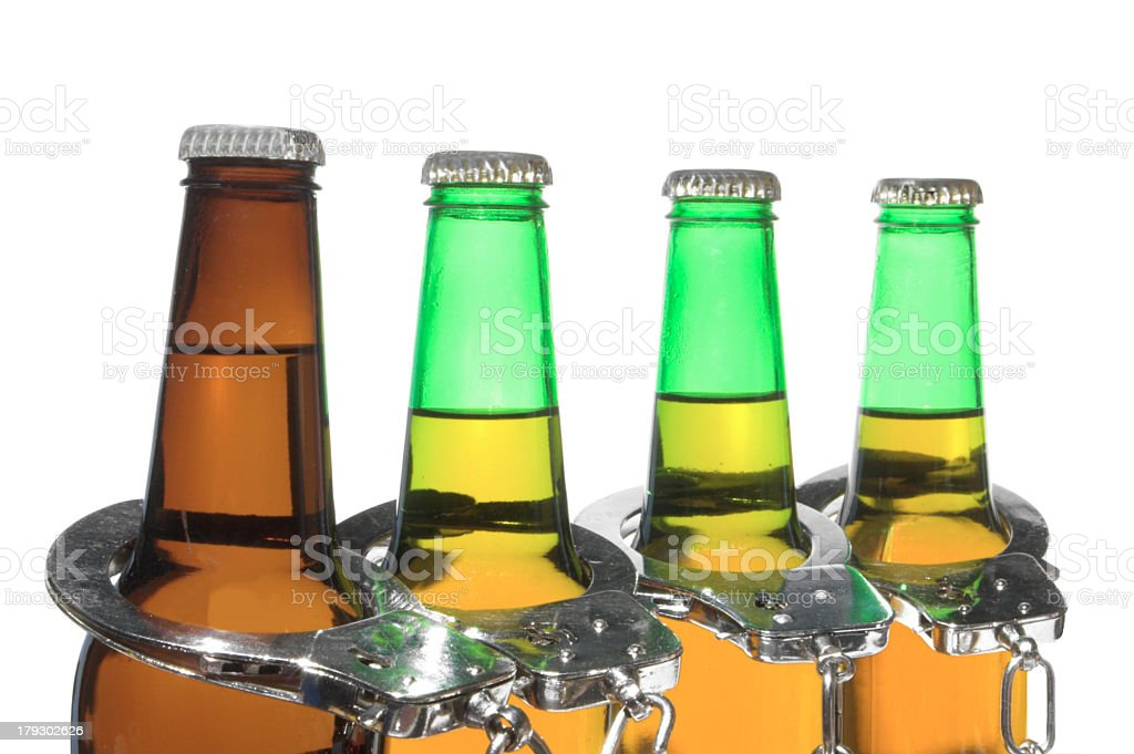 Beer and Handcuffs - Drunk Driving Concept stock photo