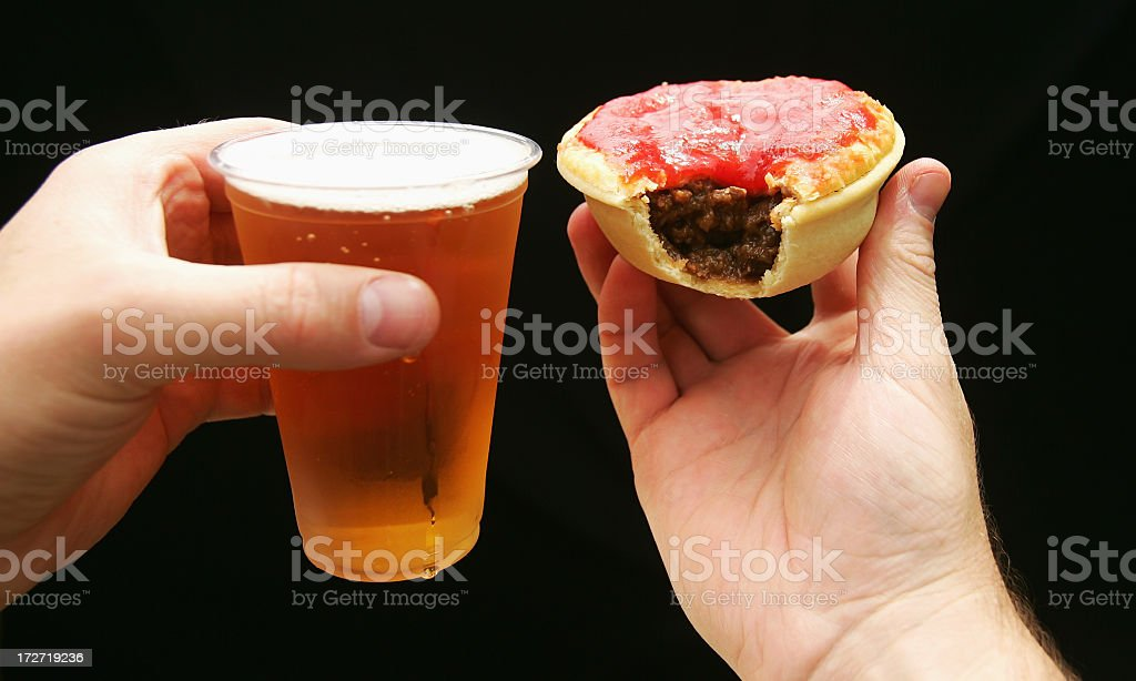 Beer and Meat Pie with Sauce stock photo