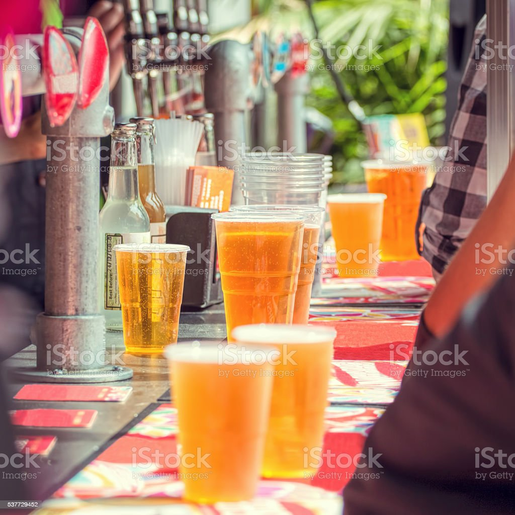 Beer and people at outdoor bar. stock photo