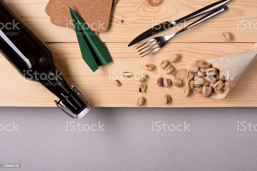 Beer and pistachio nut snack on wooden table. stock photo