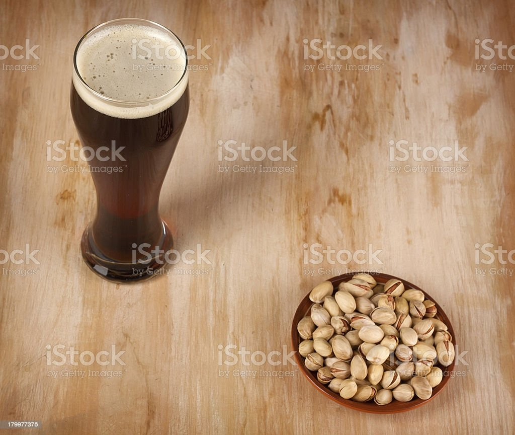 Beer and pistachios royalty-free stock photo