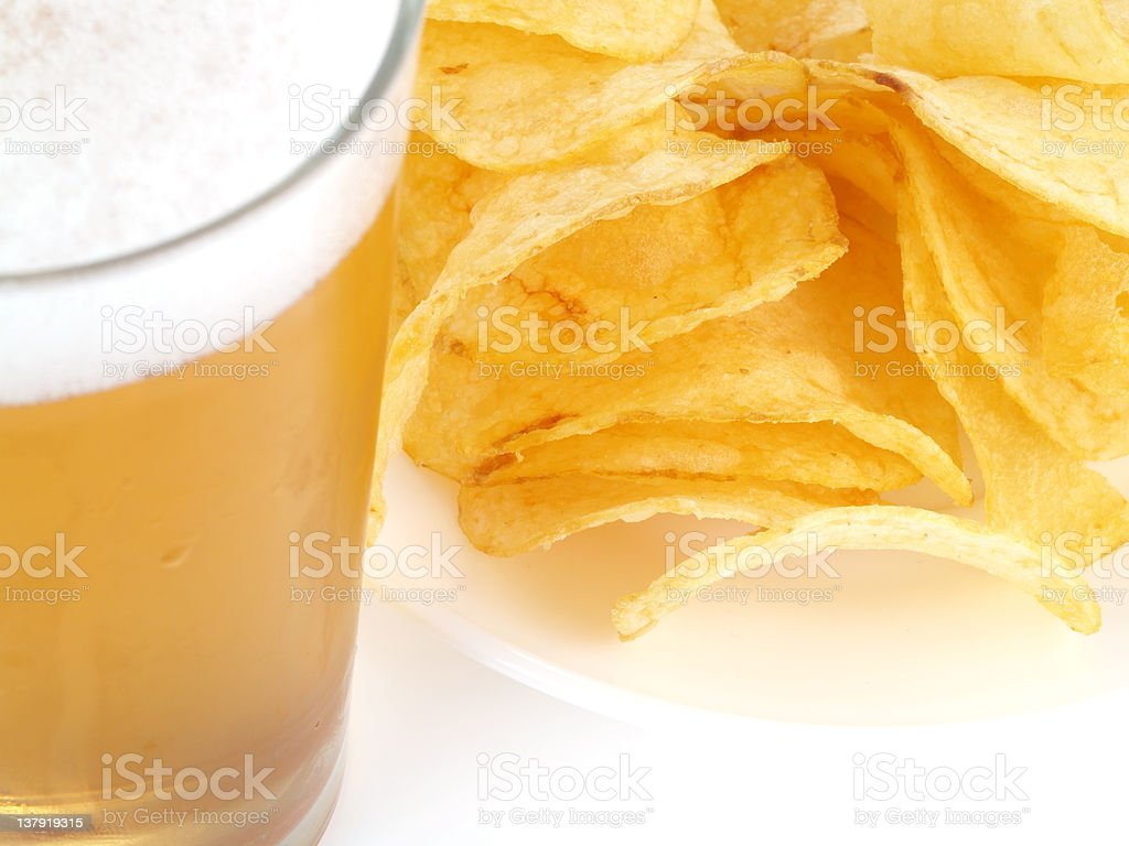 beer and potato chips. royalty-free stock photo