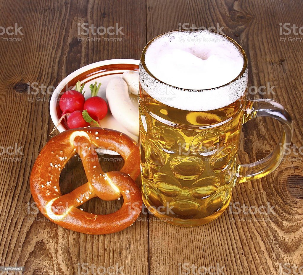 Beer and pretzel, radish with white sausage stock photo