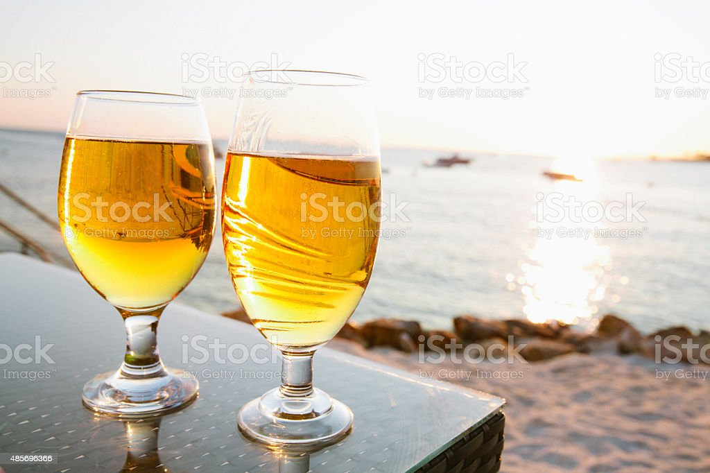 Beer and sunset stock photo