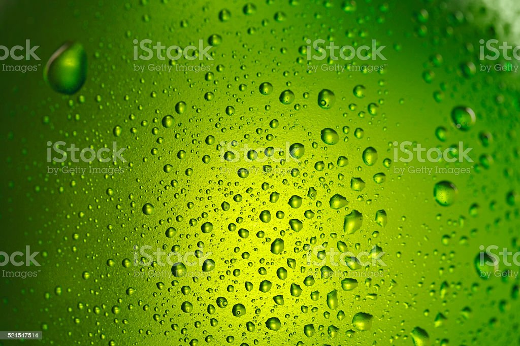 Beer Background   Ice cold  bottle covered with water drops  condensation stock photo