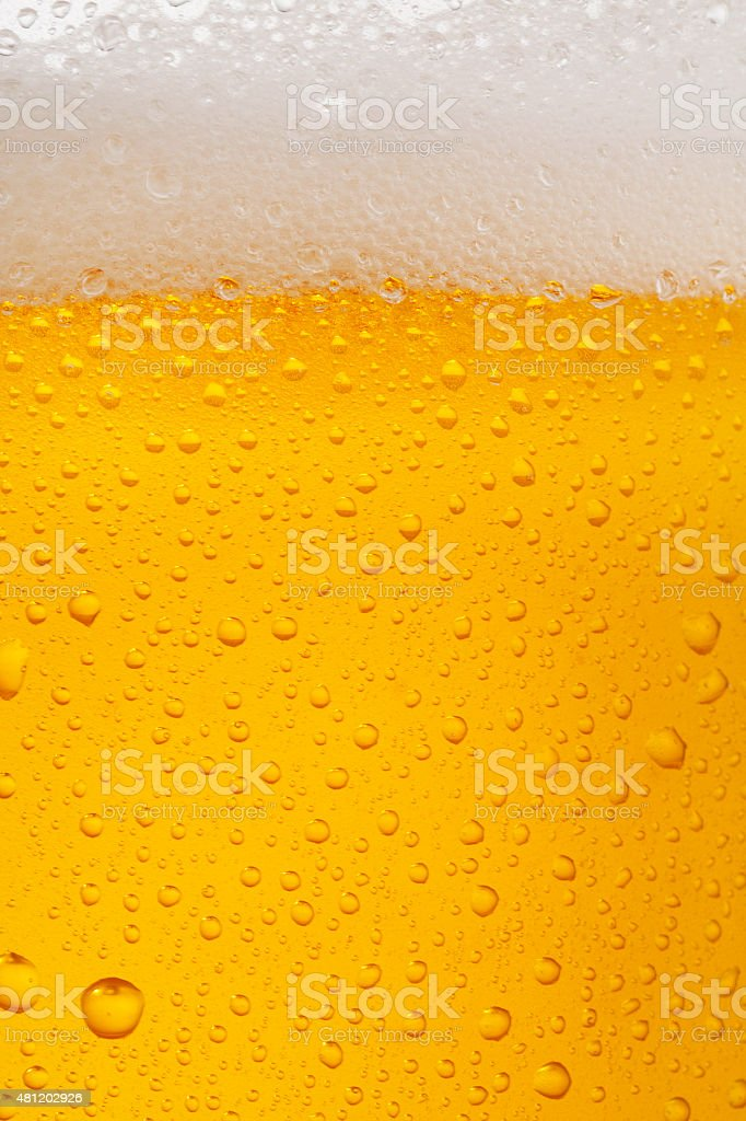 Beer Background   Ice Cold  Glass Covered with water drops  condensation stock photo
