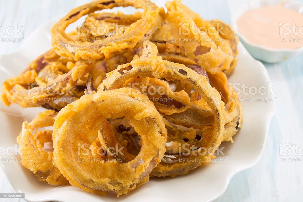 beer battered onion rings close up stock photo