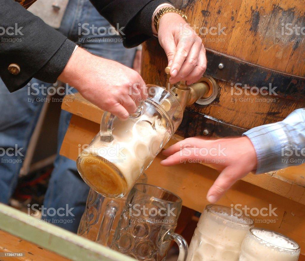 beer - Bierzapfen beim Anstich und Bieranstich with stein stock photo