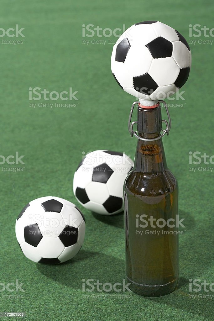 Beer bottle and balls royalty-free stock photo