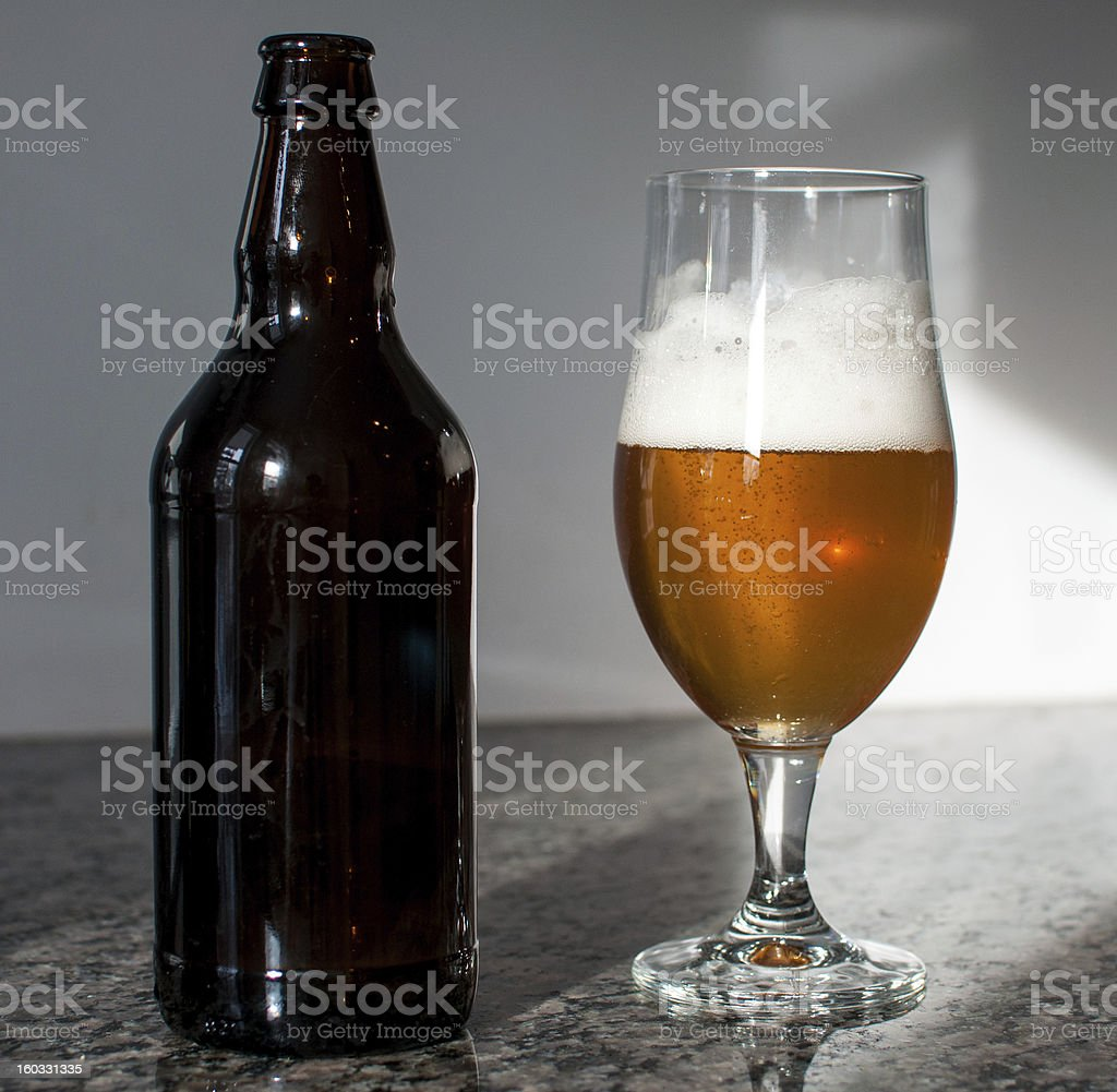 Beer bottle and glass stock photo