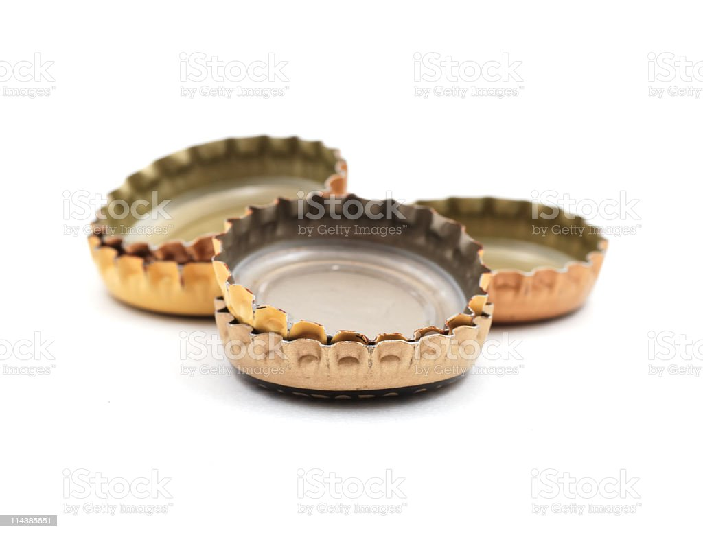 Beer bottle caps upside down on a white background stock photo