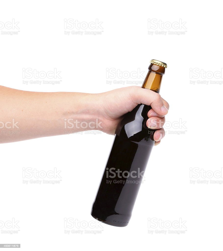 Beer bottle in the hand isolated on white royalty-free stock photo