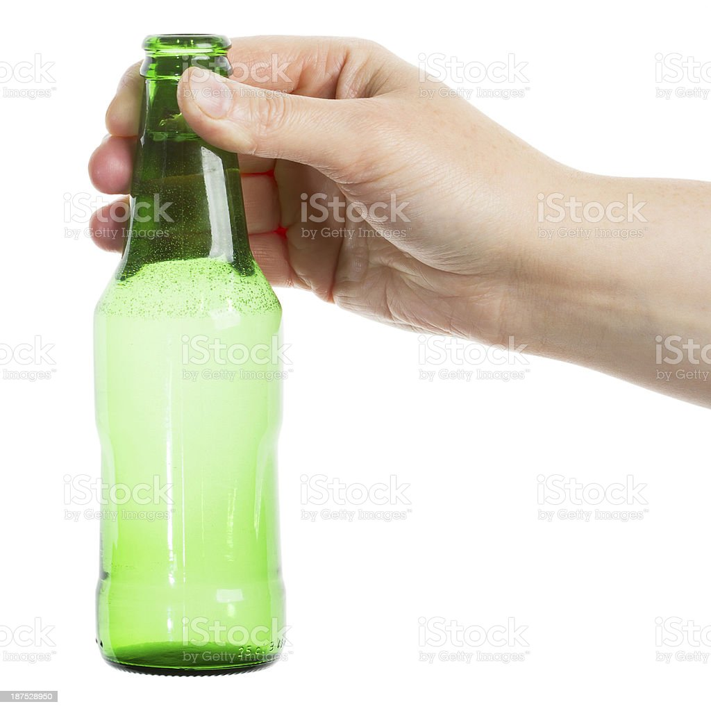 Beer bottle in the hand royalty-free stock photo