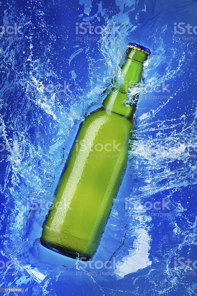 beer bottle in water royalty-free stock photo