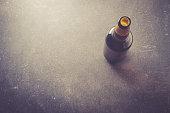 Beer bottle on dark table