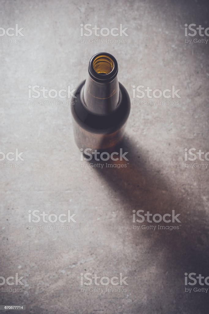 Beer bottle on dark table stock photo