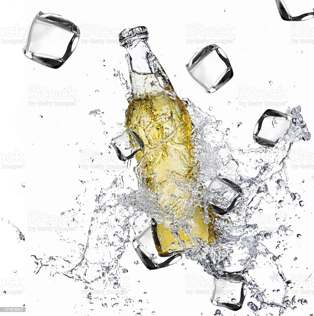 Beer bottle on ice cubes royalty-free stock photo