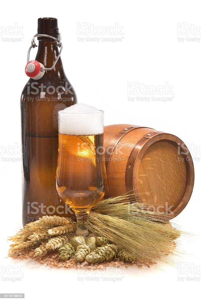 XXL beer bottle with beer glass stock photo