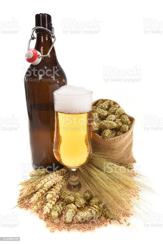 XXL beer bottle with beer glass stock photo