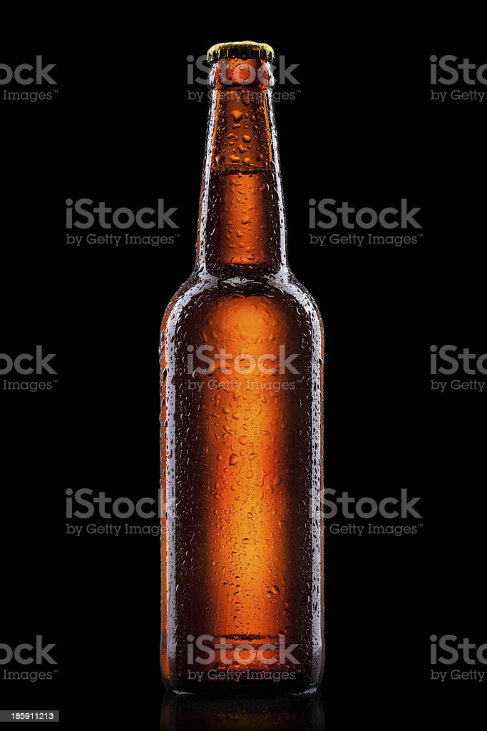 Beer bottle with water drops isolated on black stock photo