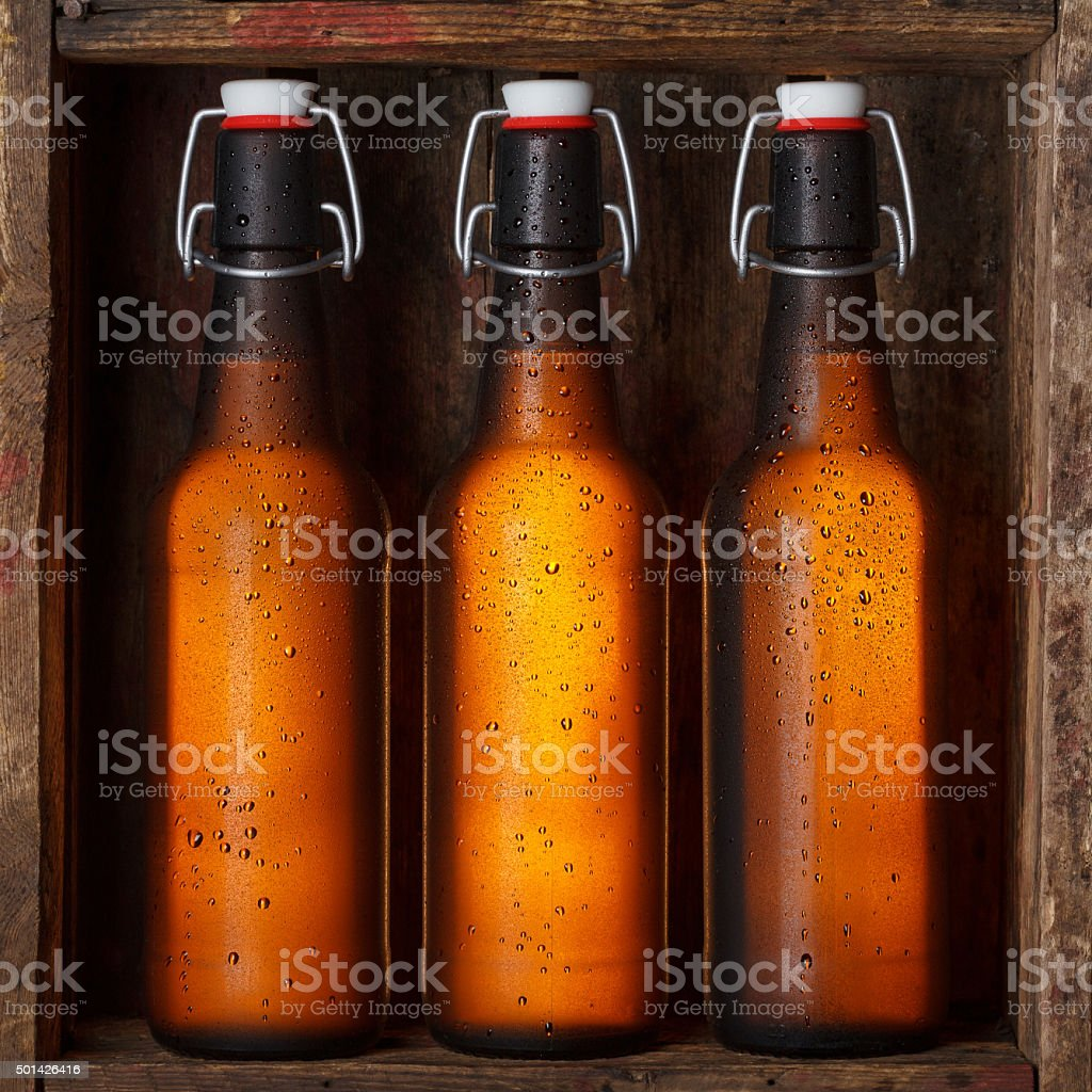 Beer bottles  in old wooden crate stock photo