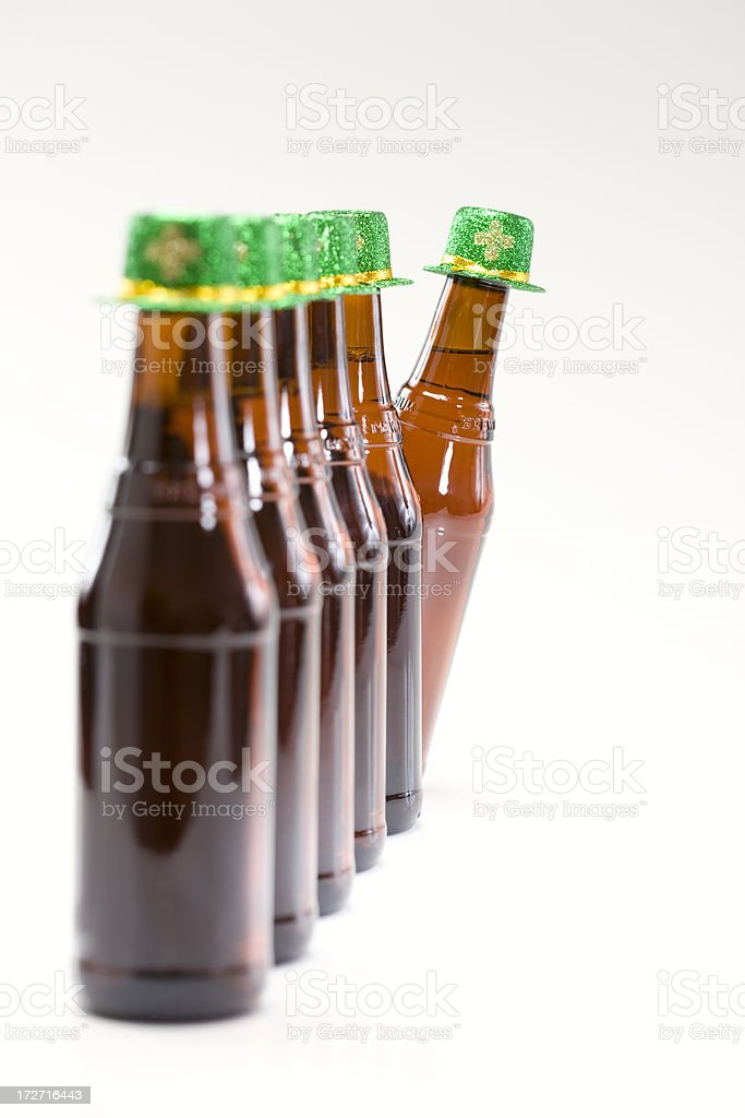 Beer Bottles in Row with St Patricks Day Hats, Copyspace royalty-free stock photo