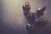 Beer bottles on dark table