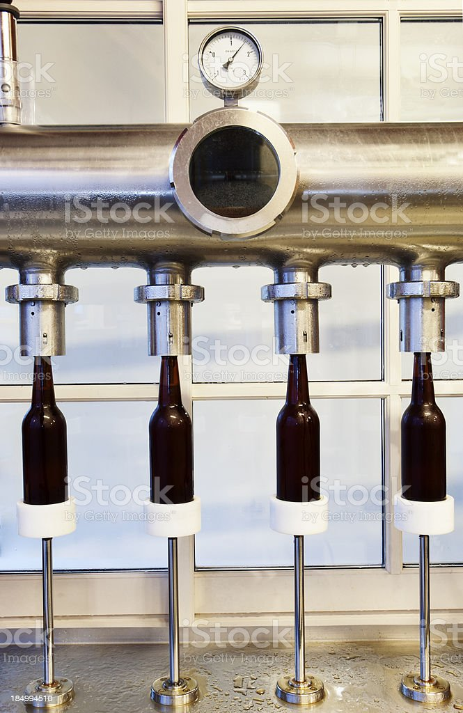 Beer Bottling in a Micro Brewery royalty-free stock photo