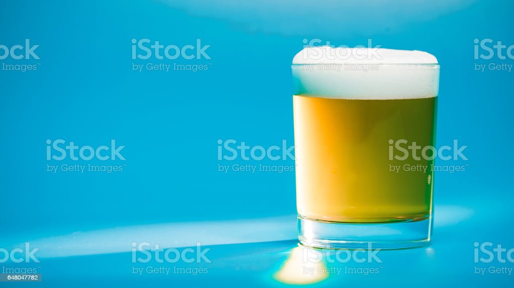 Beer closeup over blue stock photo