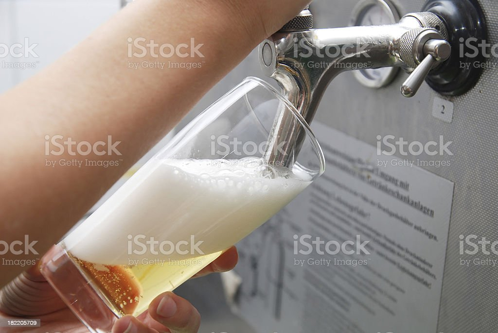 beer drawing with hand in beerglass - zapfanlage stock photo