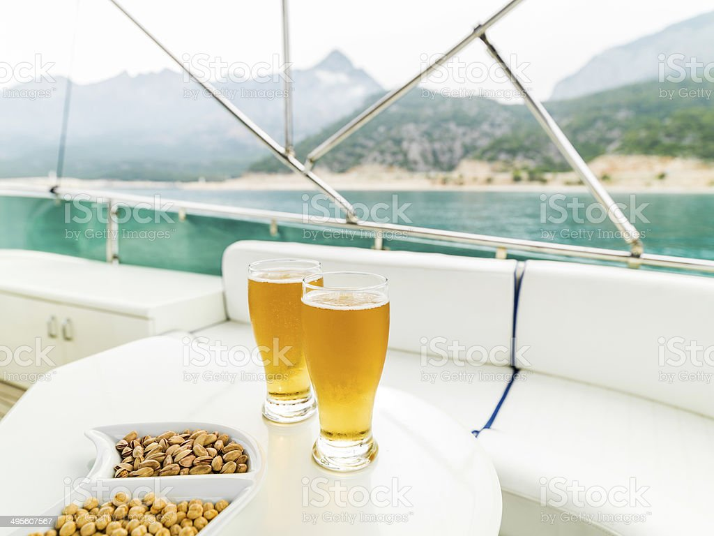 Beer enjoy in the yacht stock photo