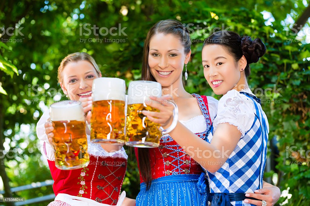 Beer garden - friends in traditional clothes in bavaria stock photo