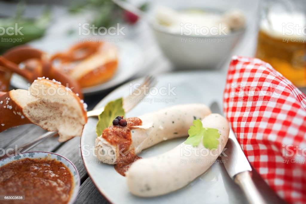 Beer garden with white sausage stock photo