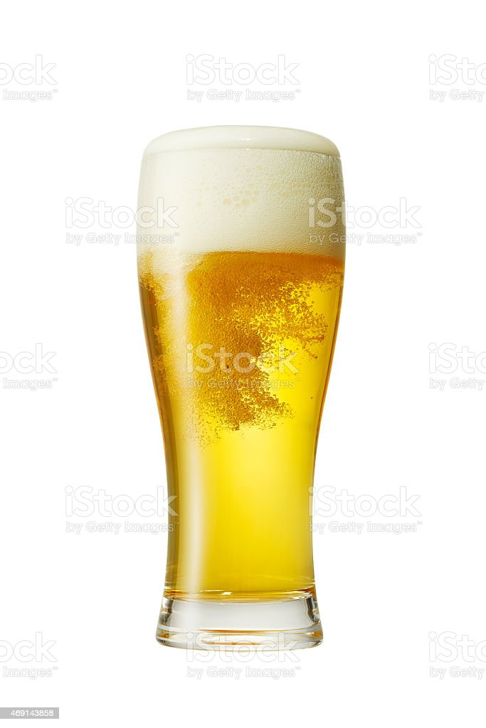 Beer glass foaming over a white background stock photo