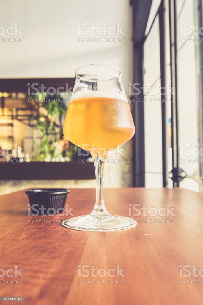 Beer glass on the bar counter vintage filter stock photo