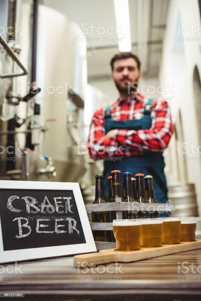 Beer glasses and sign with manufacturer stock photo